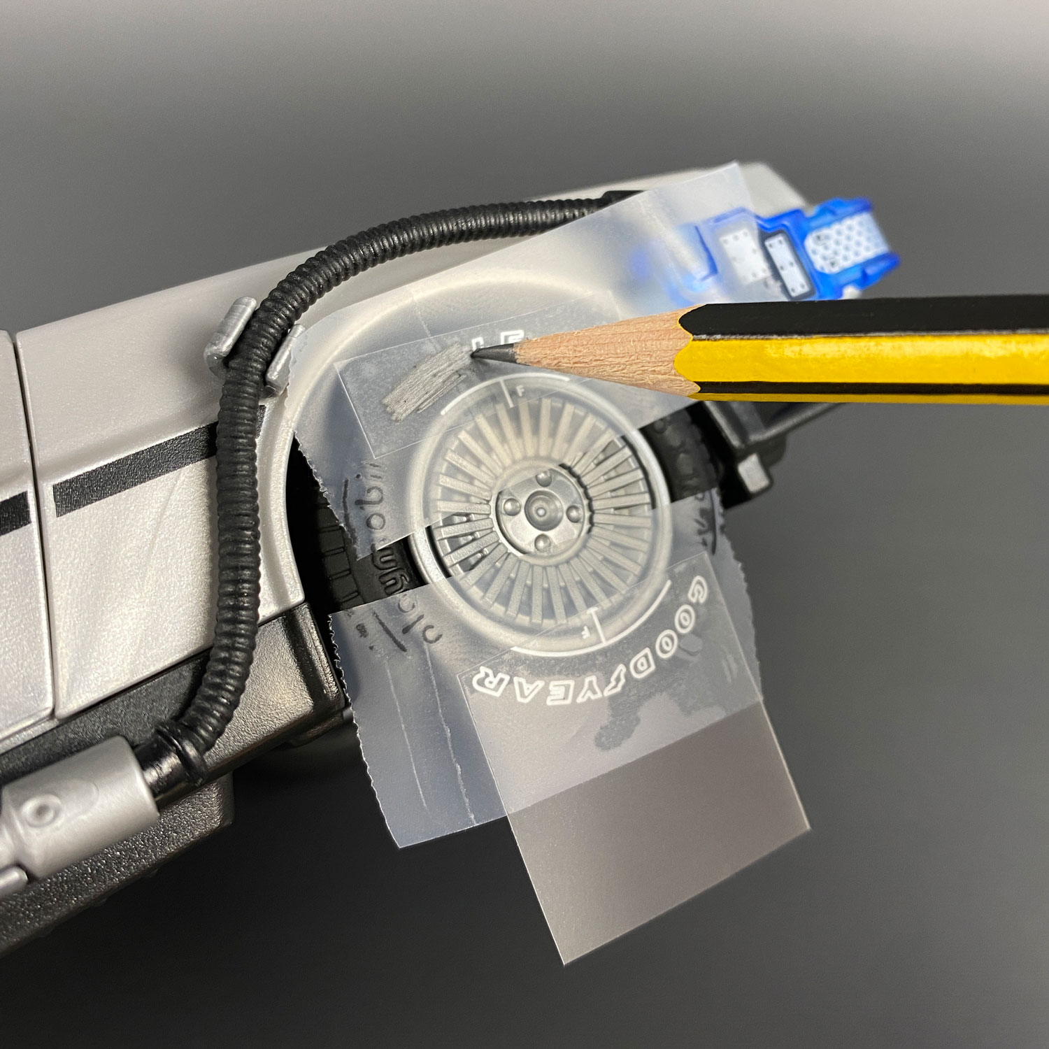 Using pencil point to apply Playmobil DeLorean Tyre Transfers